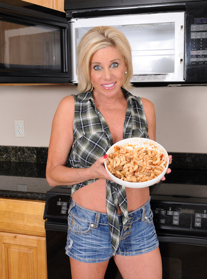 Payton Hall nukes some food and then takes off her little shorts to tease