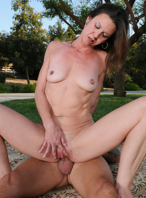 Horny mature Jizzabelle gets some outdoor action with her hung guy pal
